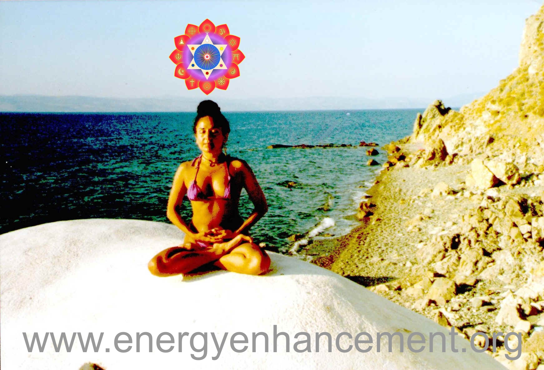 DEVI DHYANI IN LOTUS POSTURE FOCUSSING ON THE SOUL CHAKRA ABOVE THE HEAD AND THE KUNDALINI CHAKRA IN THE CENTER OF THE EARTH SPHERE..